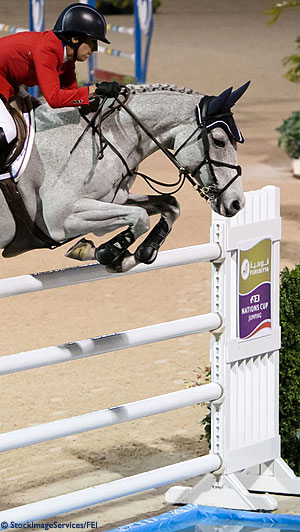Photo of Laura Kraut (USA) and Cedric jumping at the Furusiyya FEI Nations Cup in Wellington, Florida.