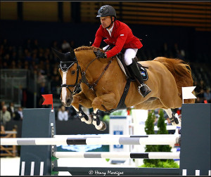 Pius Schwitzer and maiden QUIDAM-DU-V jumping to win the 1st round at the 2014 World Cup Finals in Lyons, France. - Photo: © Henry Moreigne Photography (HMP)