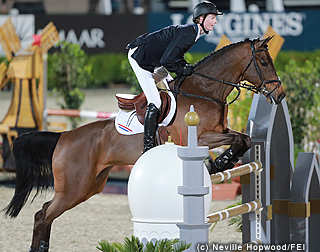 Image of Dutch team rider Frank Shuttert on Winchester HS jumping the Furusiyya fence in the inaugural Nations Cup Abu Dhabi(Al Ain) CSIO5*