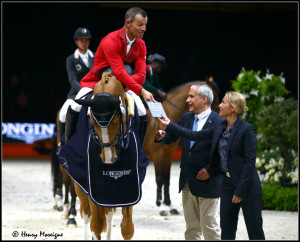 Pius Schwitzer and maiden QUIDAM-DU-V won the 1st round at the 2014 World Cup Finals in Lyons, France. Receiving award. - Photo: © Henry Moreigne Photography (HMP)